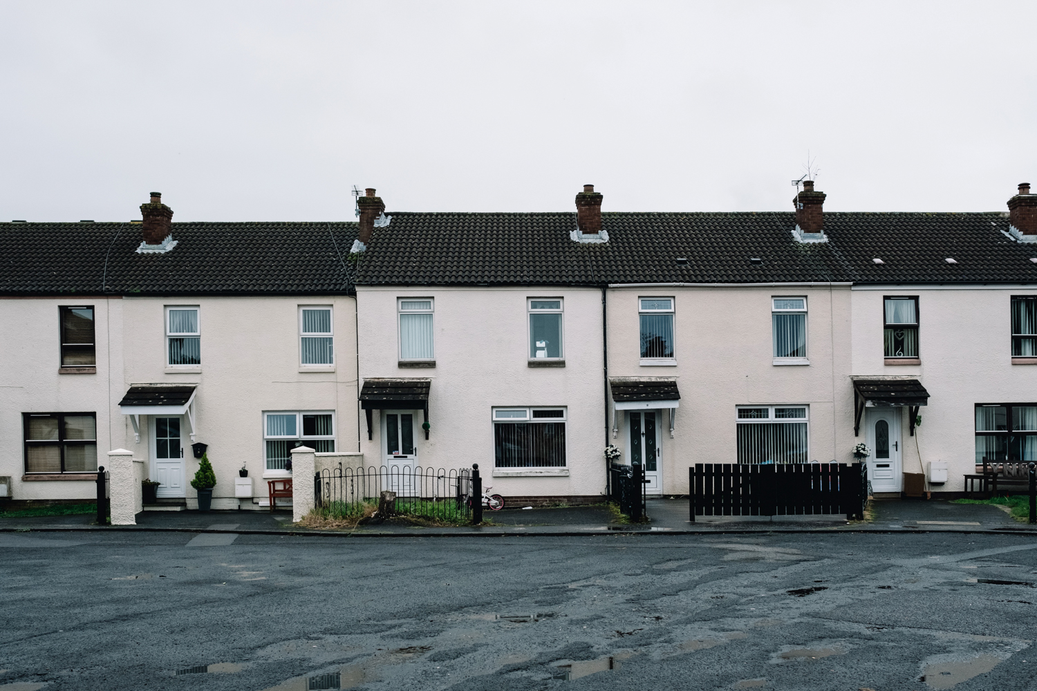 A row of semi-detatched houses in a Northern Irish street.