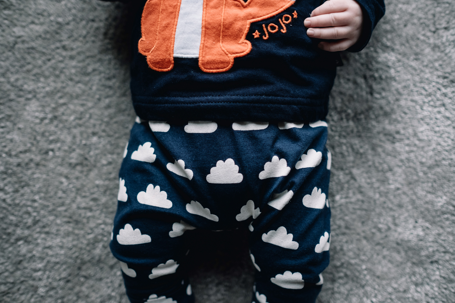 Close up of a baby's cloud leggings.