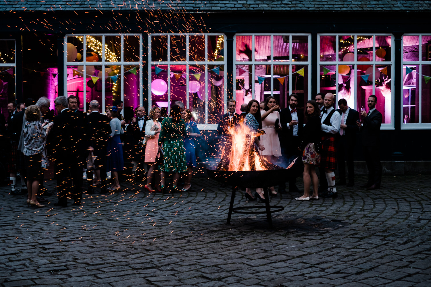Guests look on at the sparking fire pit.