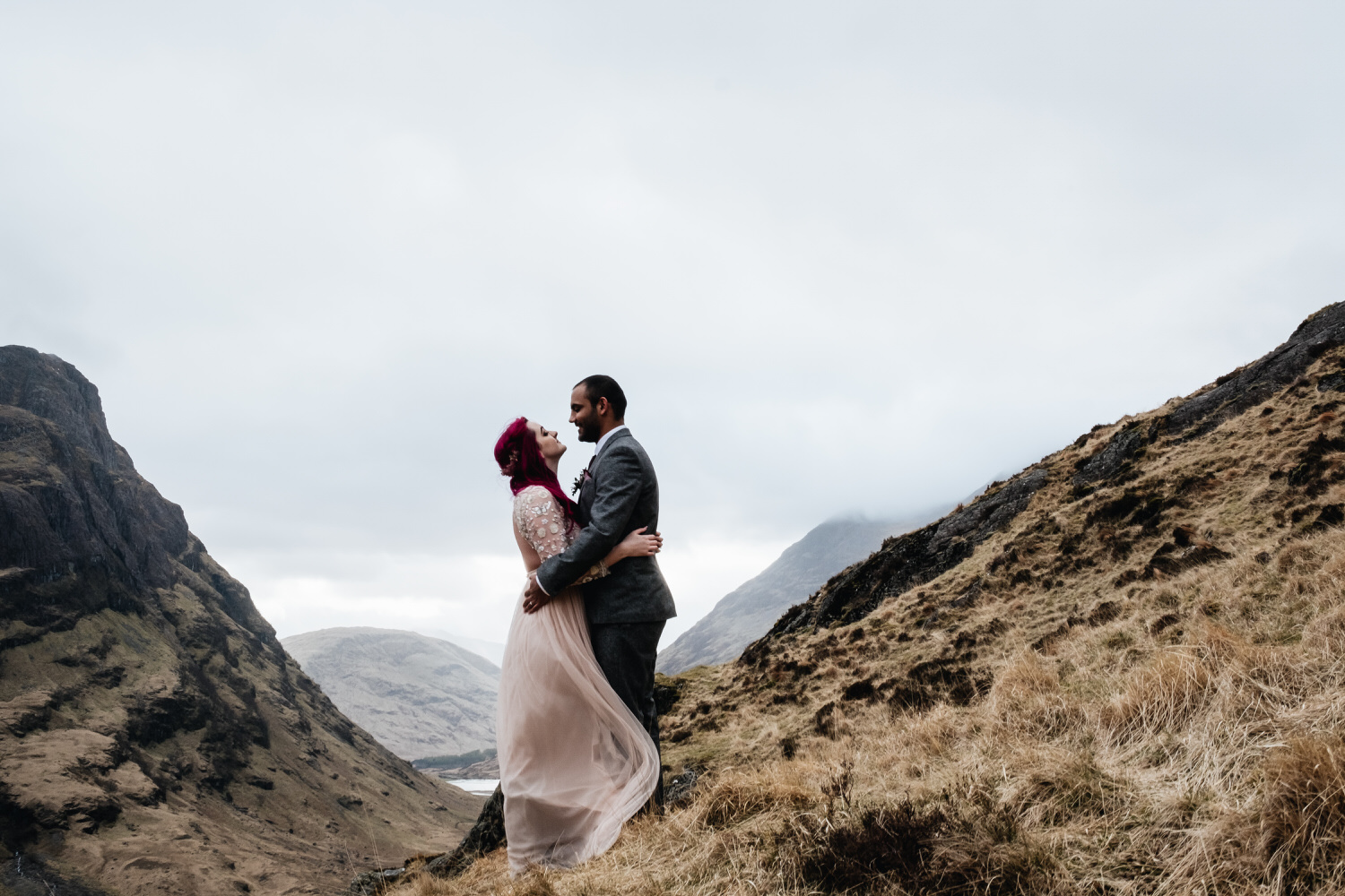 Couple embrace during their Glencoe elopement.