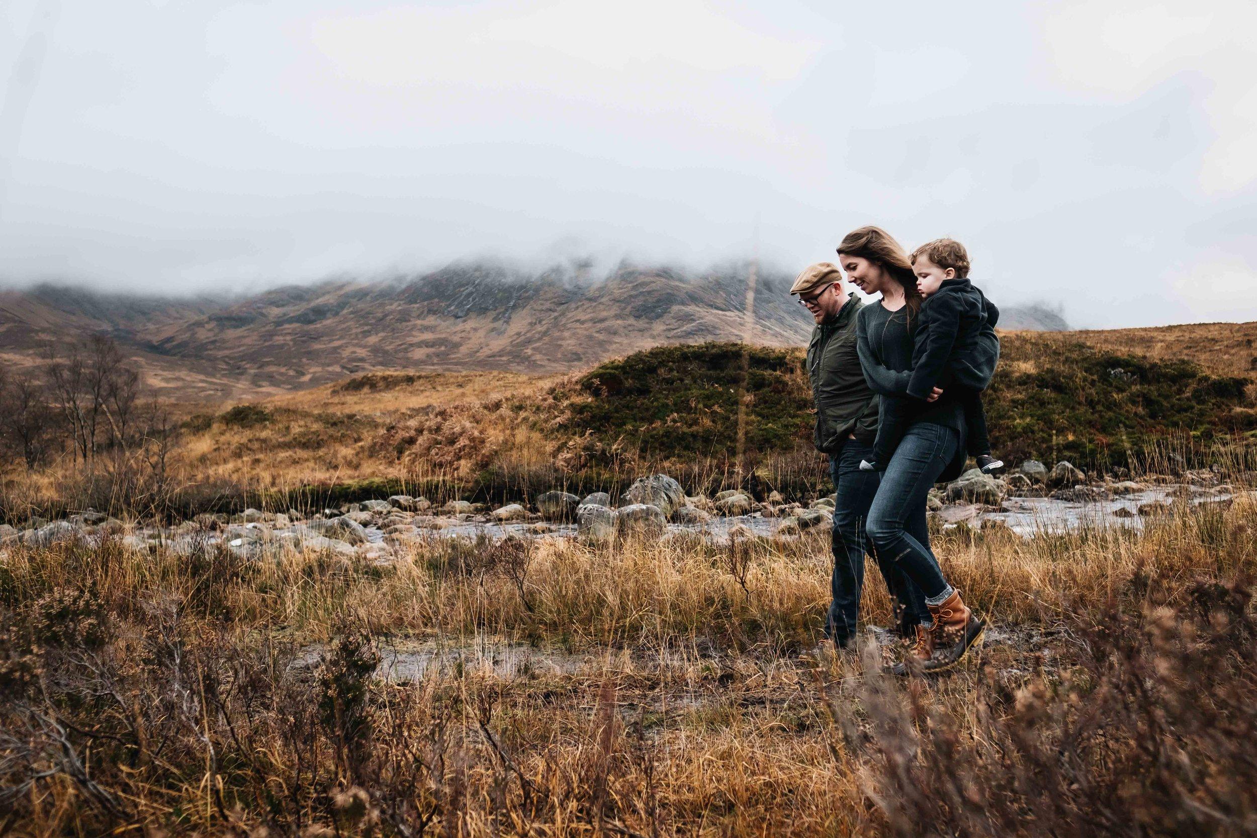 family walking in marshy field in Glencoe
