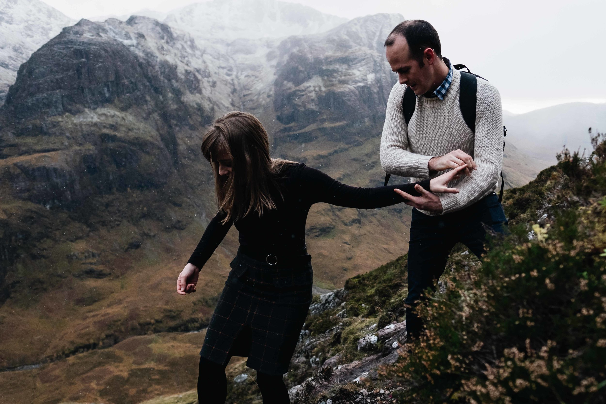 Couple climbing in Glencoe area