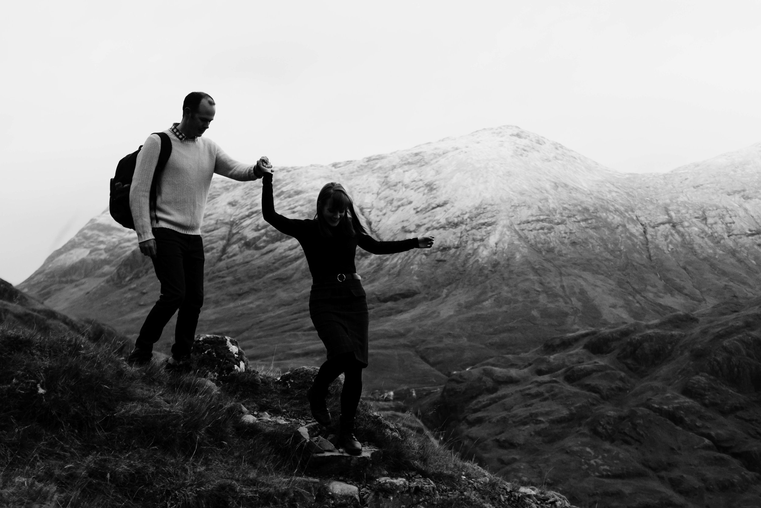 couple climbing in snowy Glencoe