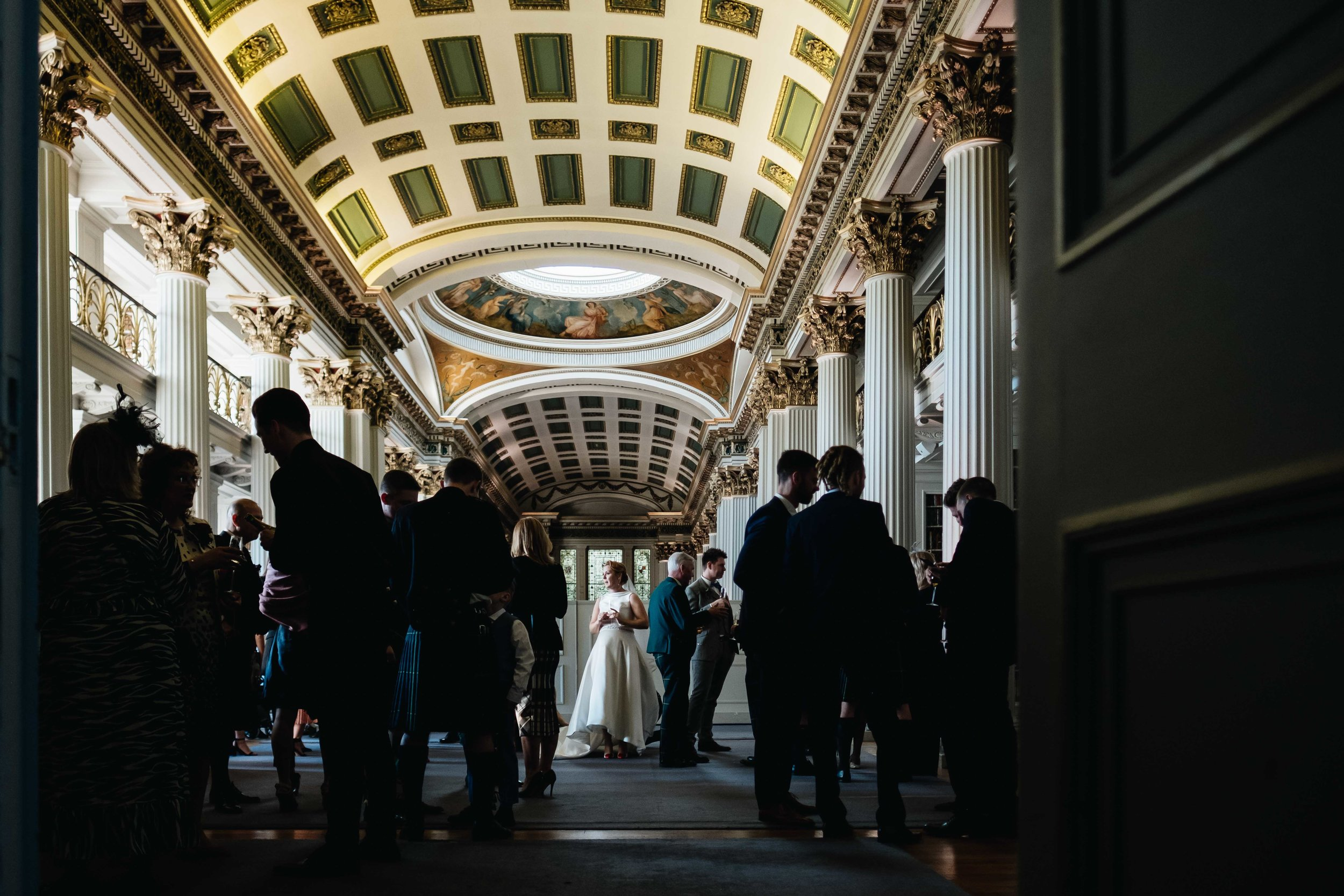 bride standing on her own in the main libary