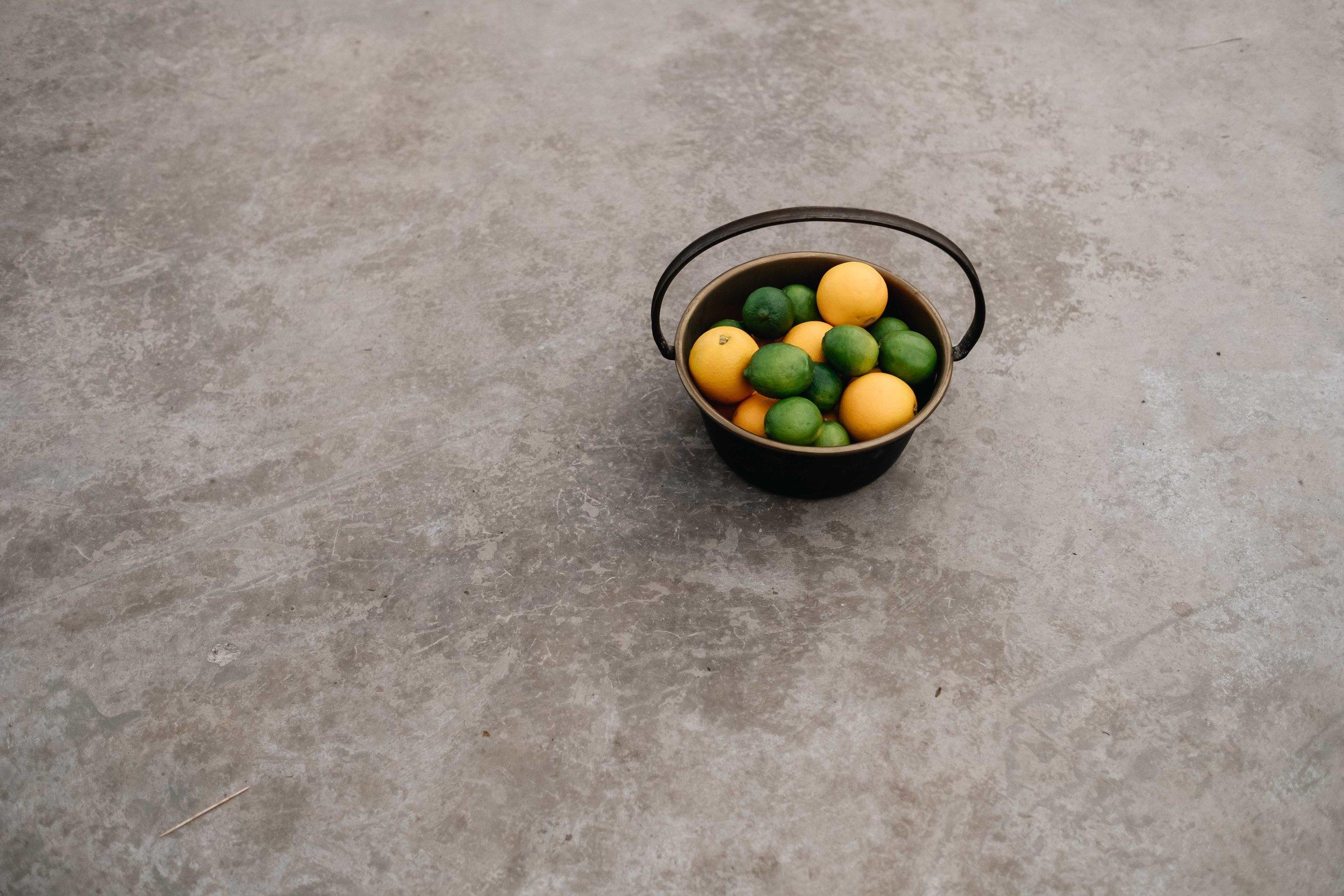 lemons and limes on the floor