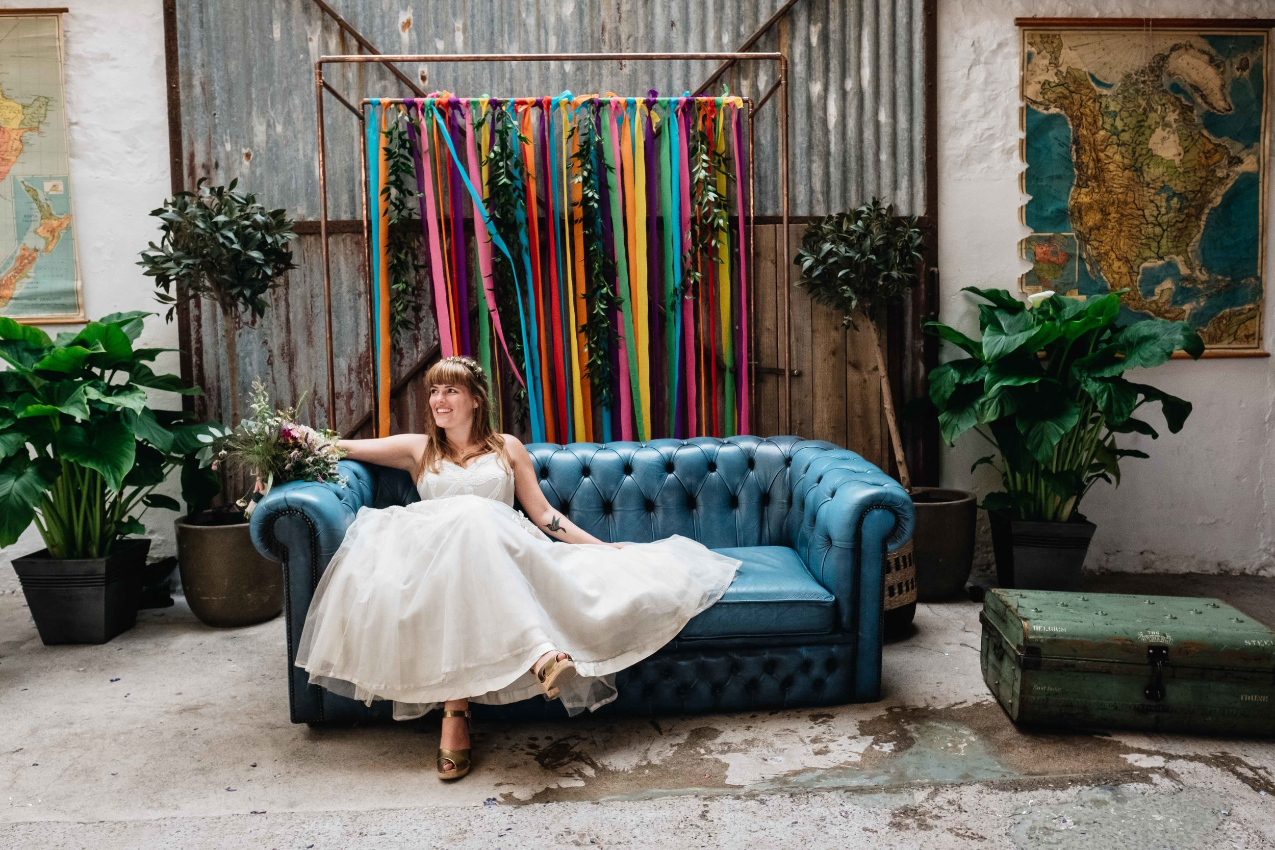 bride sitting on a leather sofa