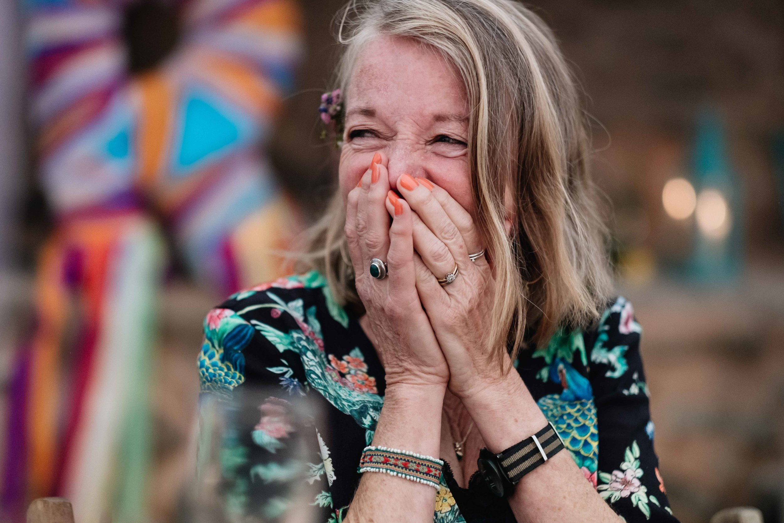 bride's mother laughing hard at soemthing the best man has said during his speech