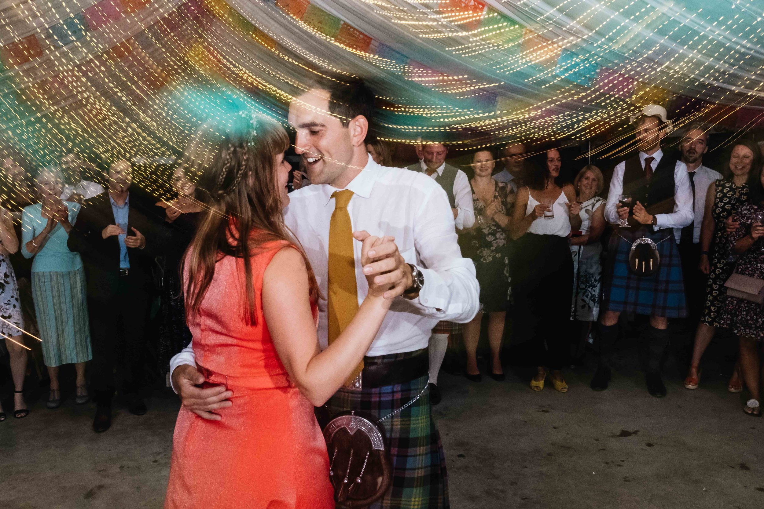 bride and groom doing a salsa for their first dance