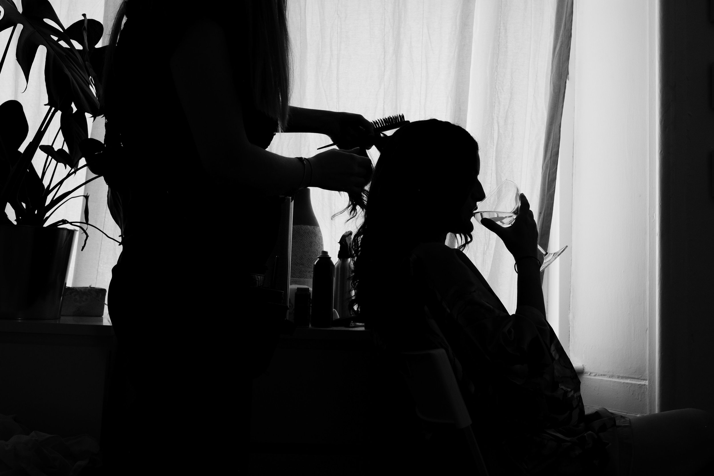 silhouette of bride drinking getting ready