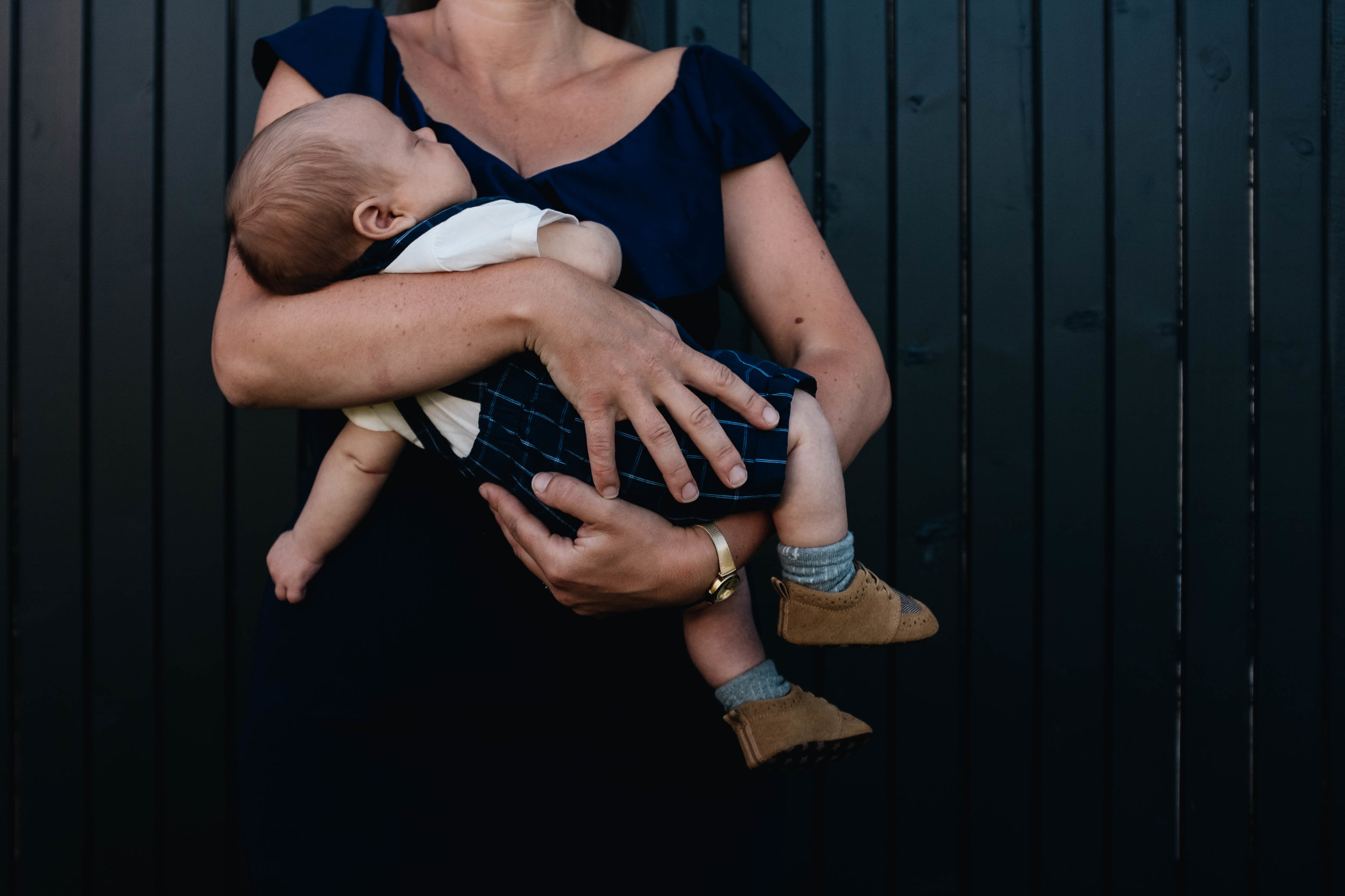 mother-holding-a-baby