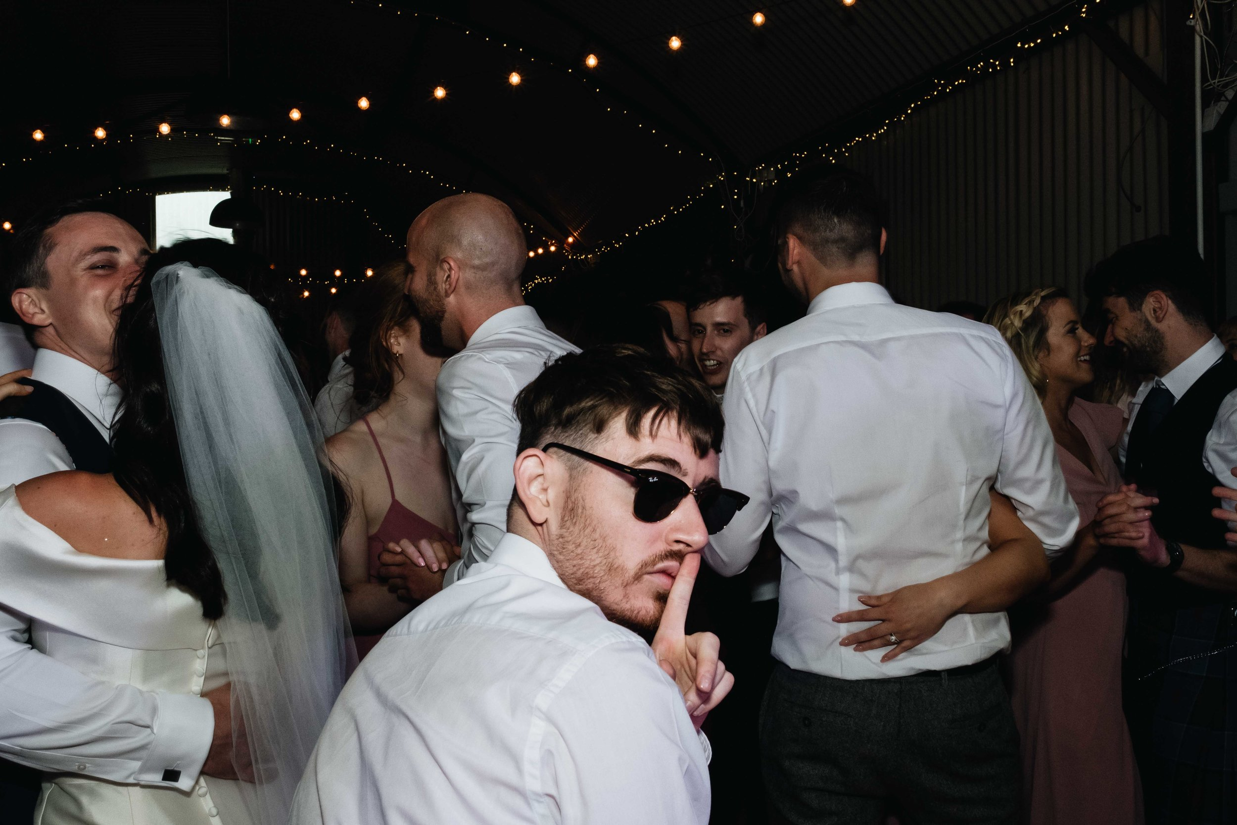 guest who is dancing is wearing sun glasses