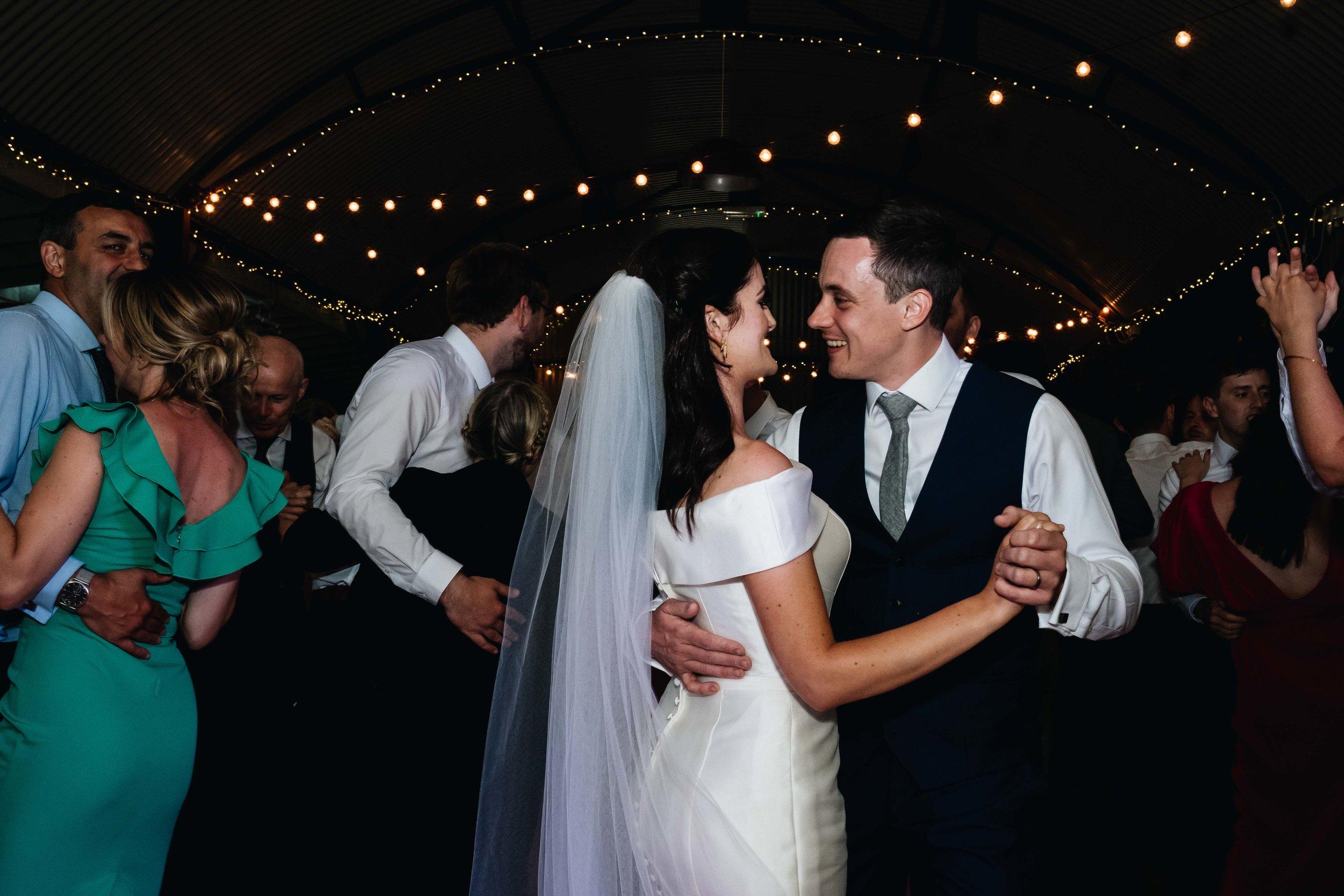 bride and groom enjoying first dance