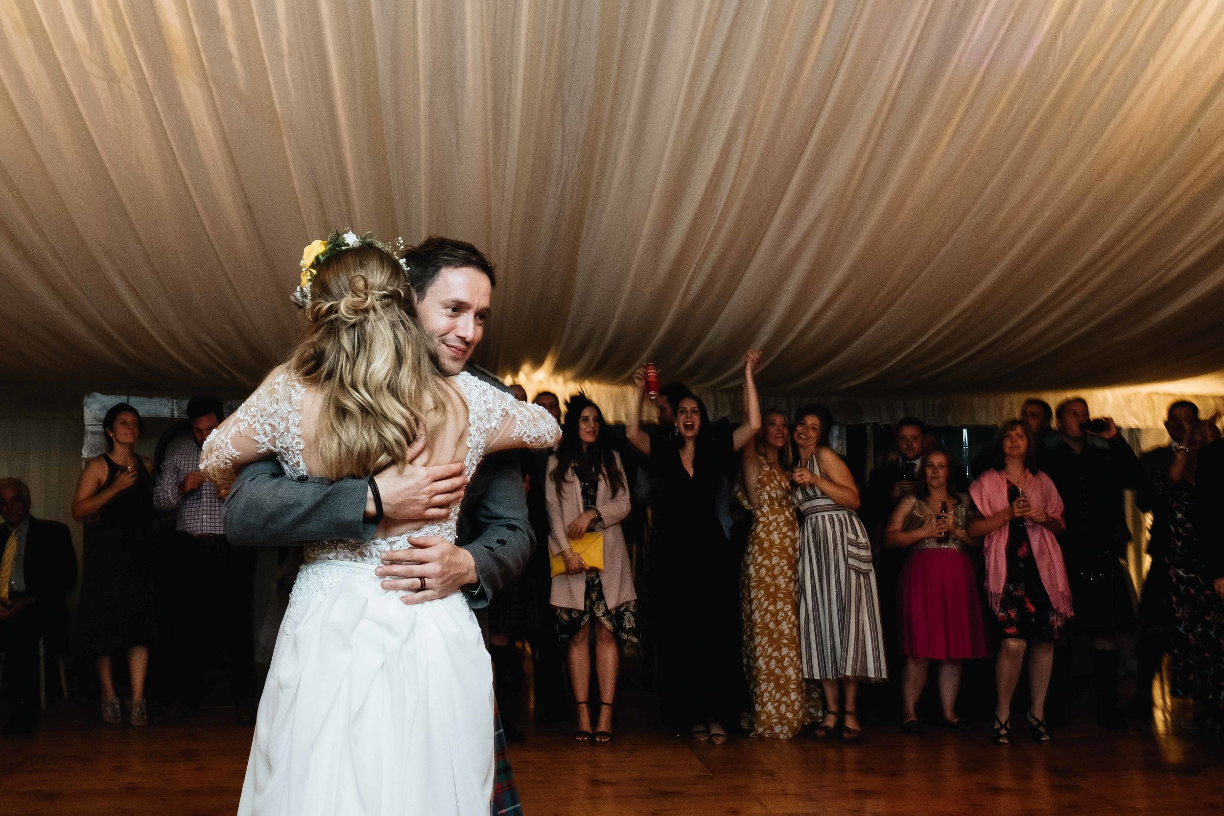 groom and bride embrace during their first dance