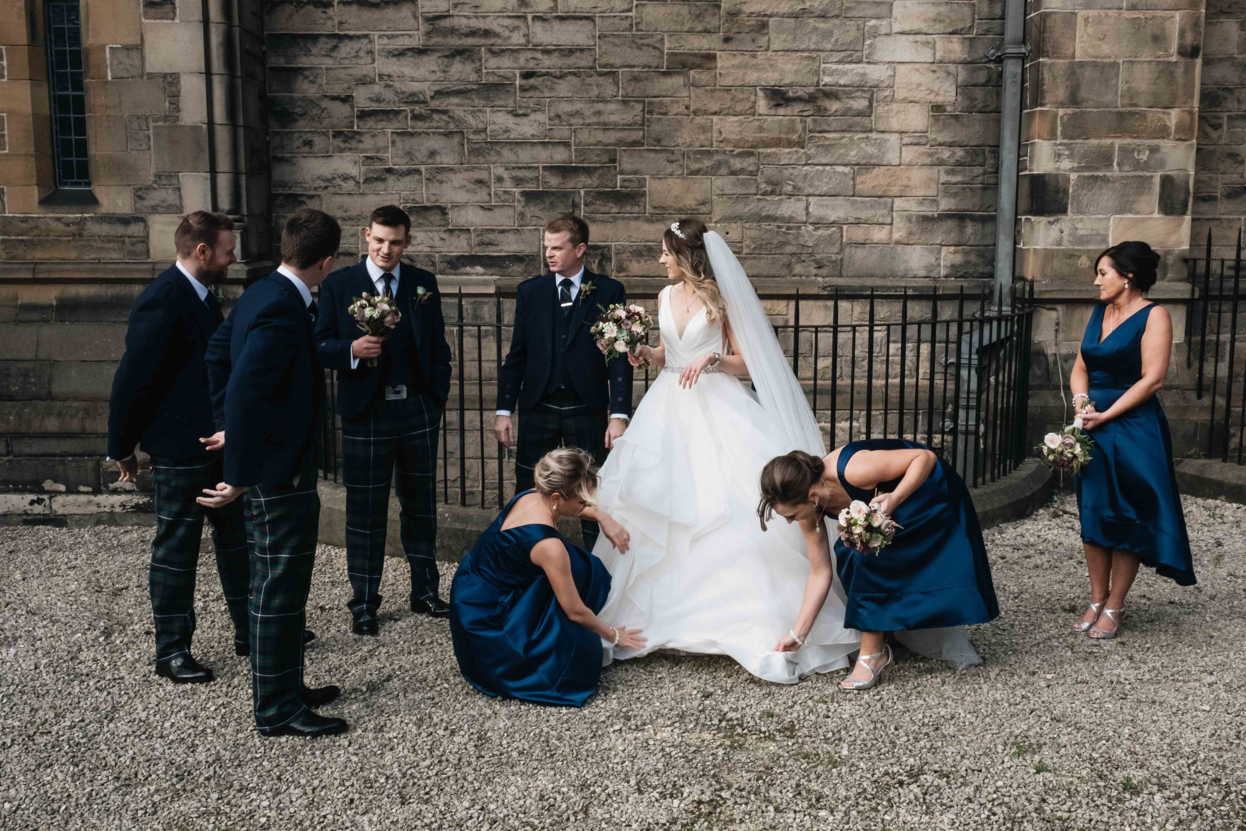 bridal party standing outside Mansfield Traquair