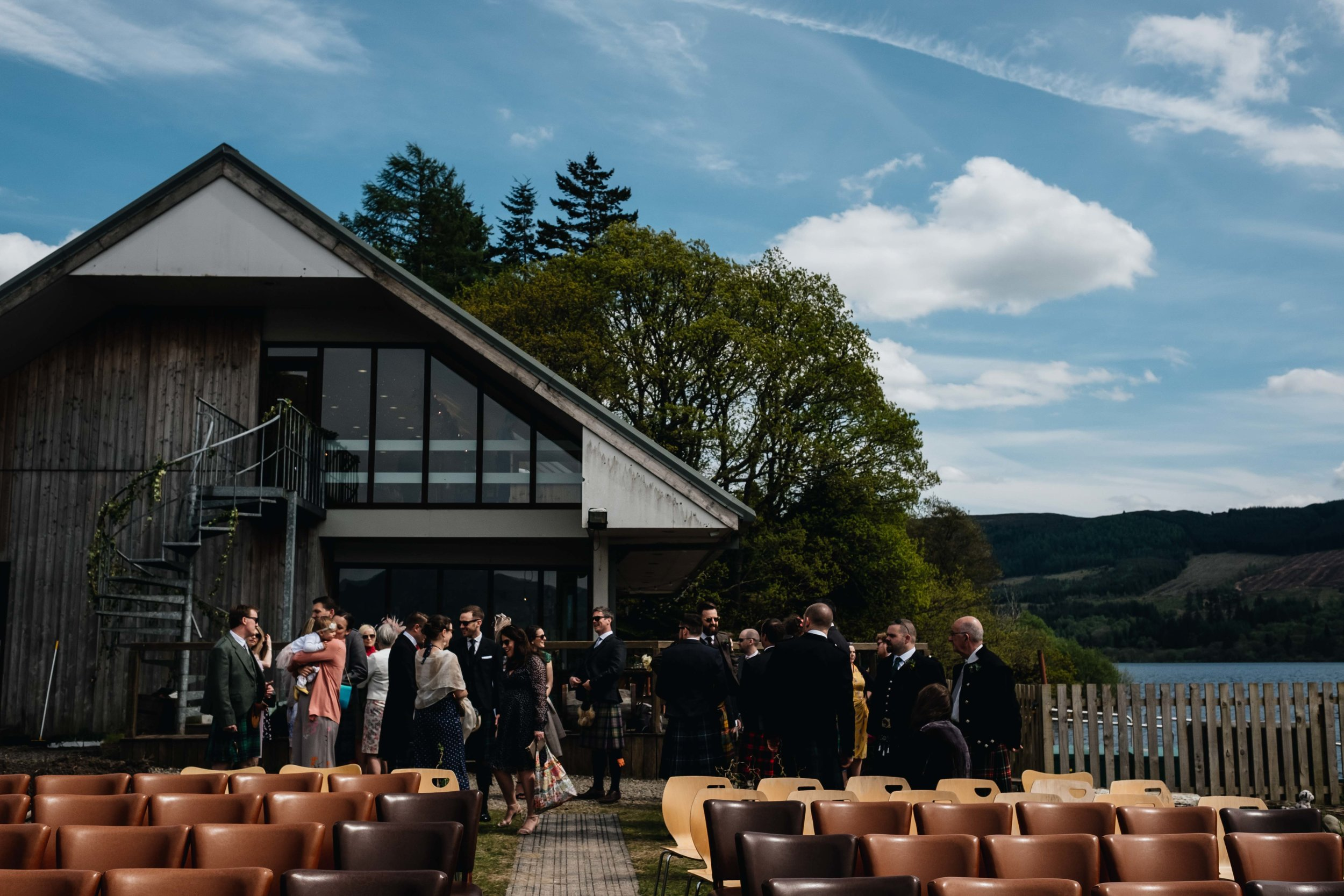 guests standing outside at Venachar Lochside for the outdoors ceremony