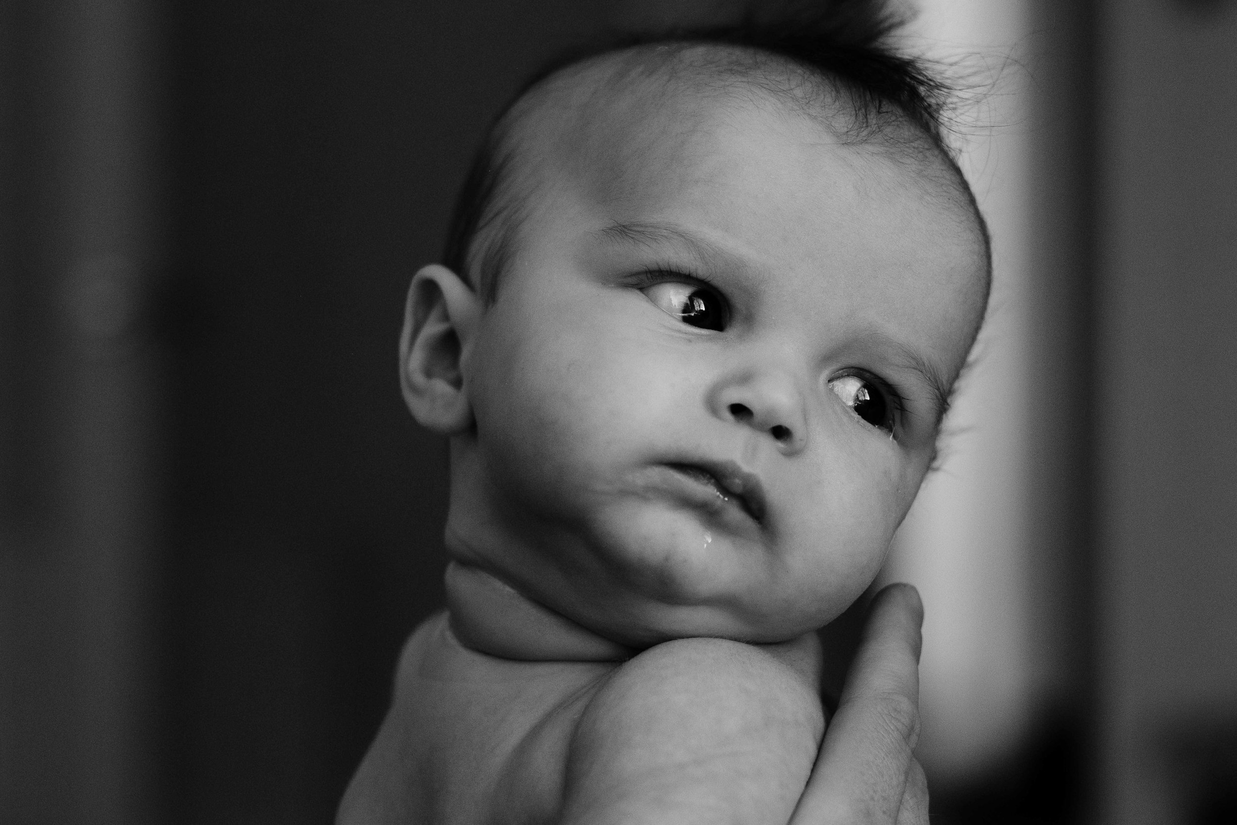 A baby is looking away from the camera