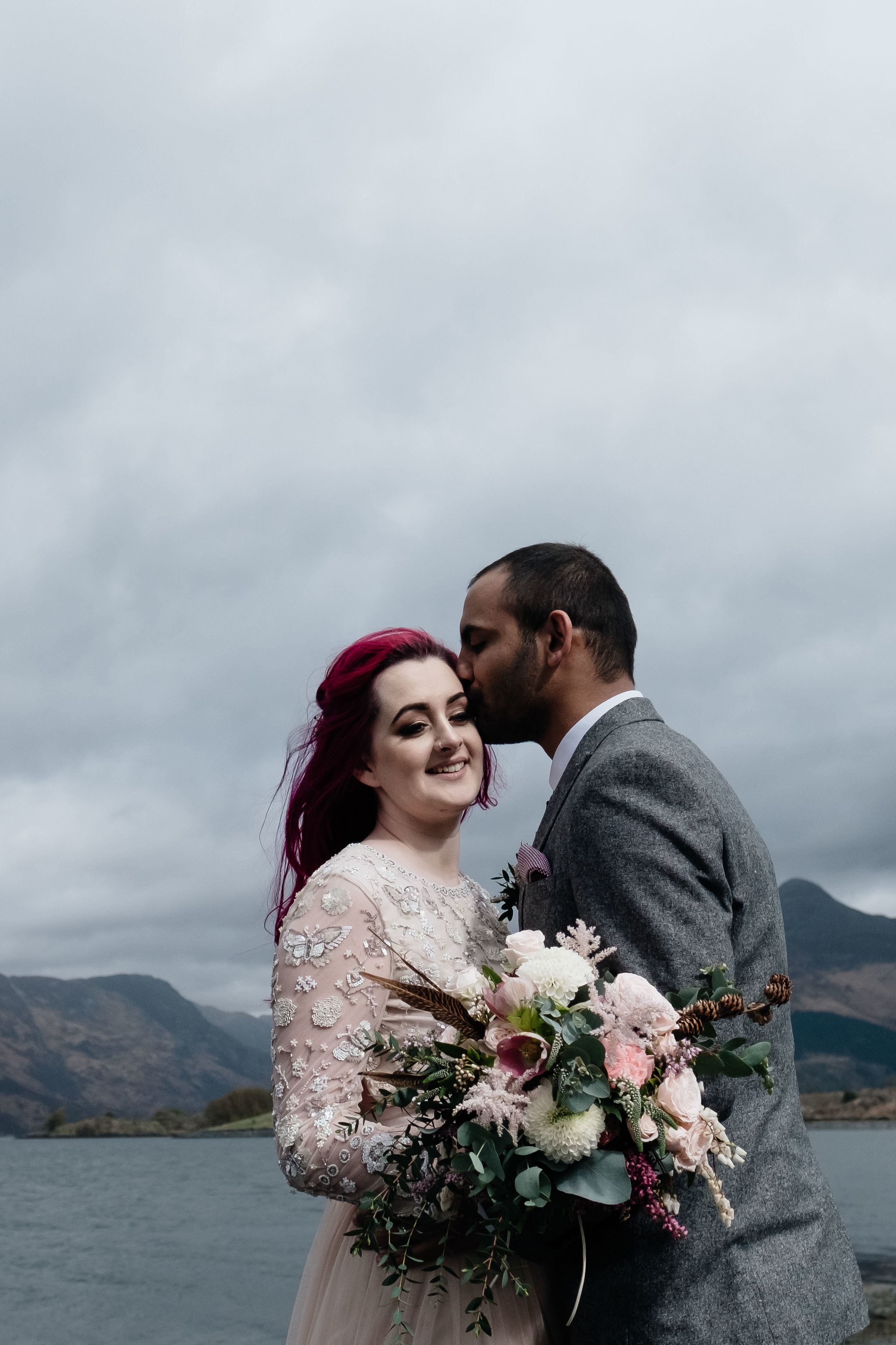 Groom kisses his bride following their Glencoe elopement.