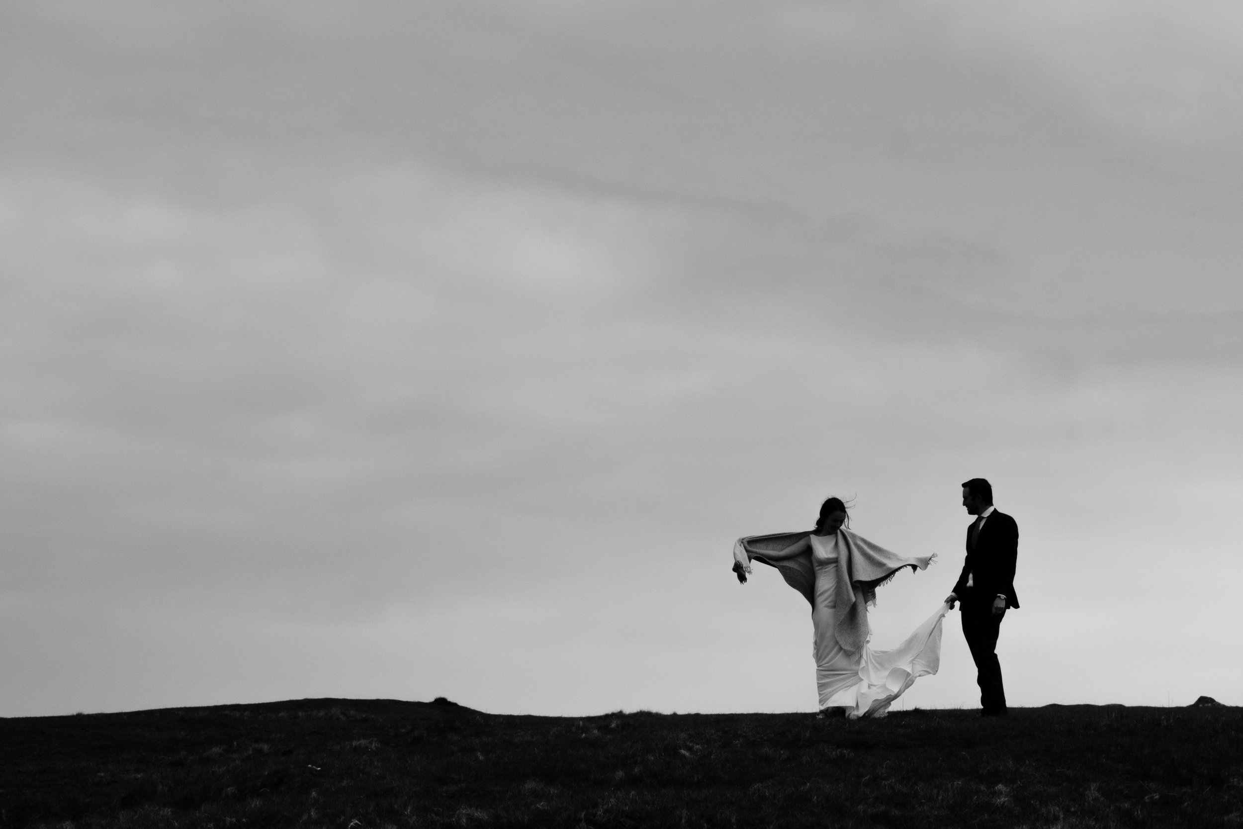 Couple standing at top of the hill