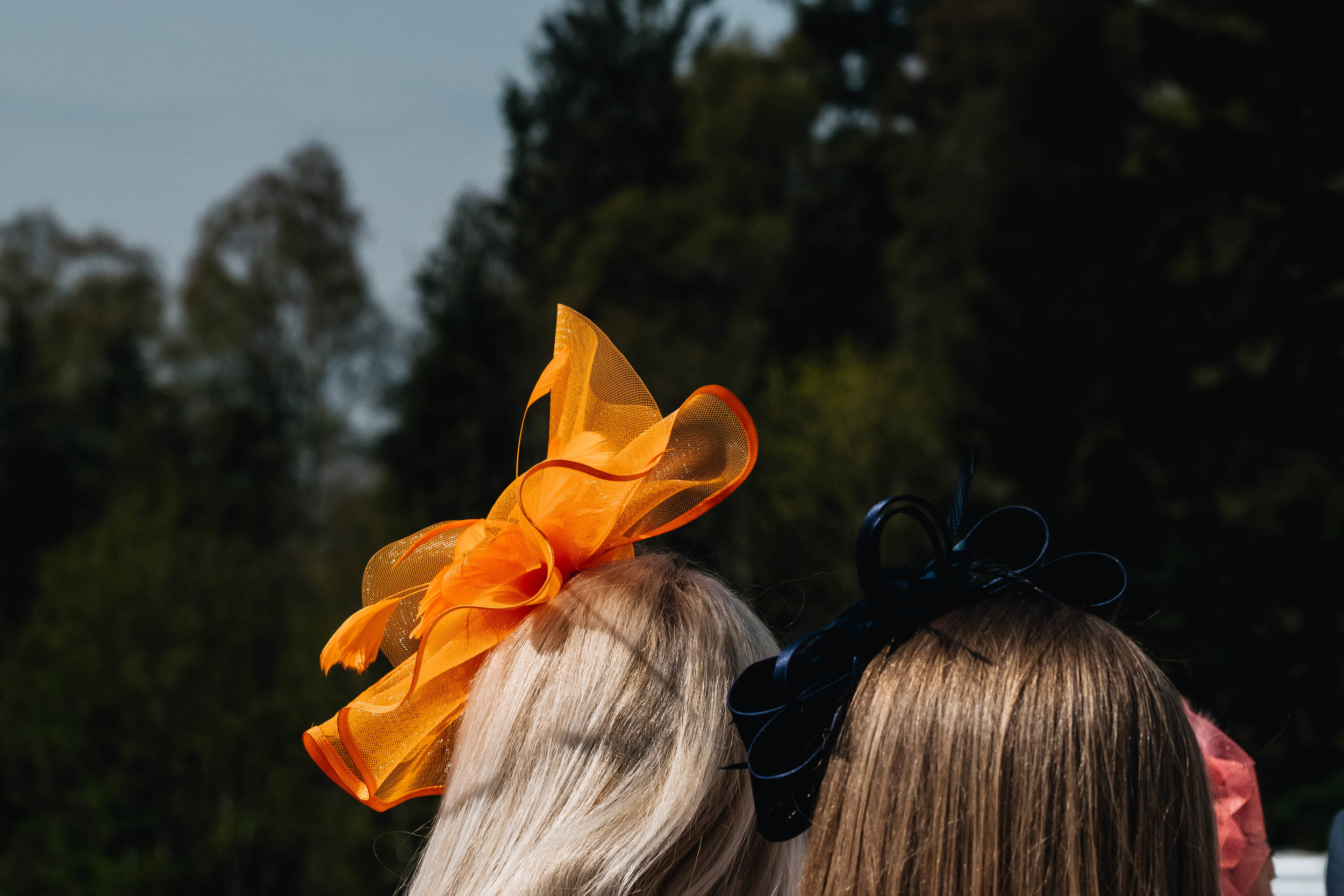 guest wearing and orange head piece