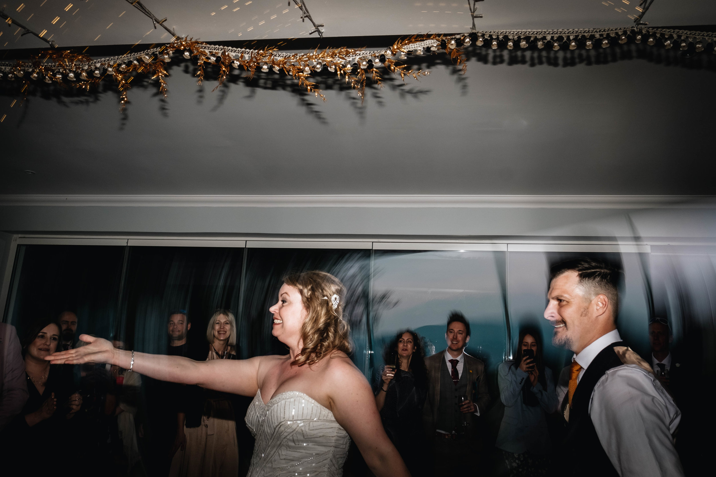 bride and groom are enjoying the energy of the dance floor