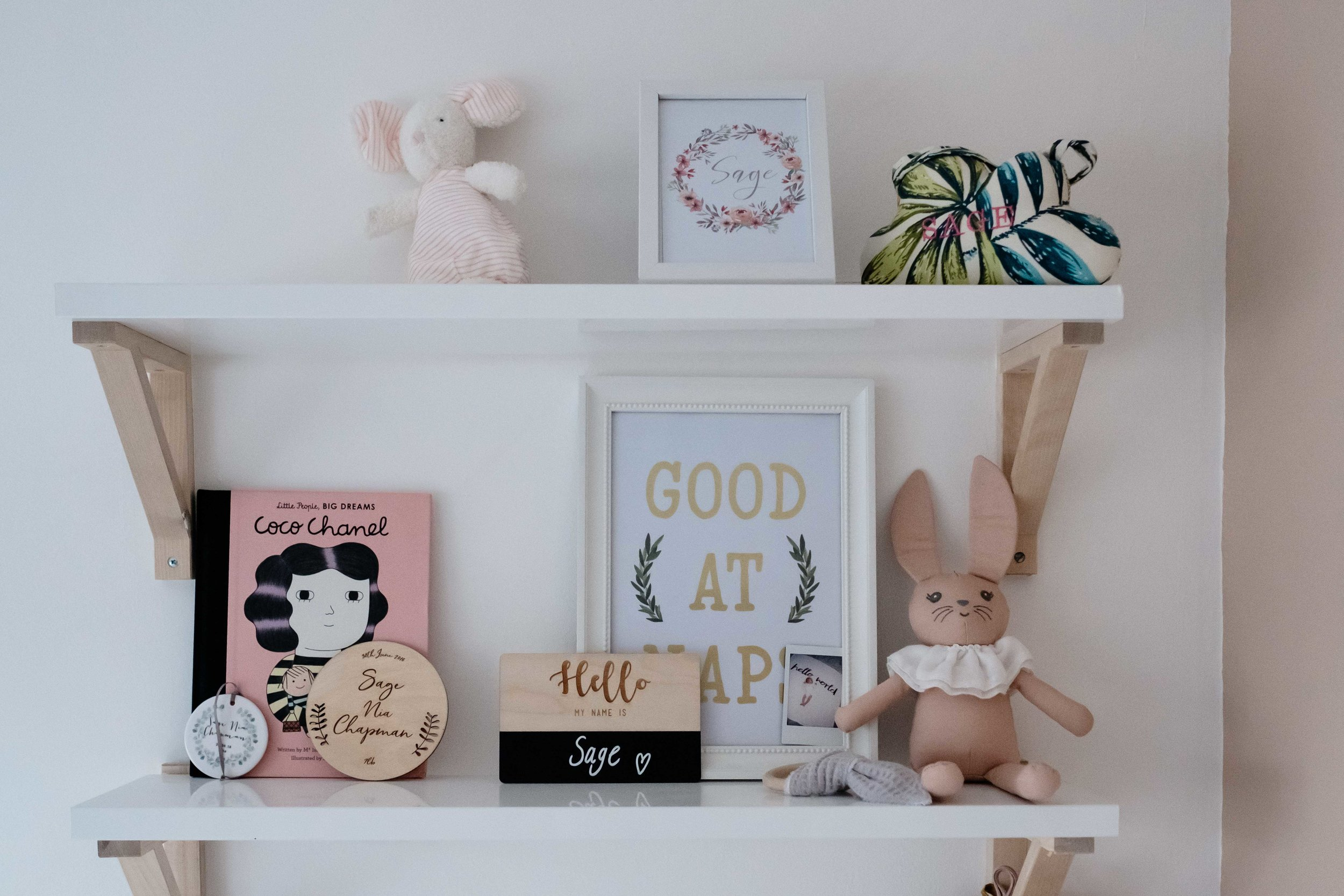 Baby girl's bedroom shelving with contemporary reading materials