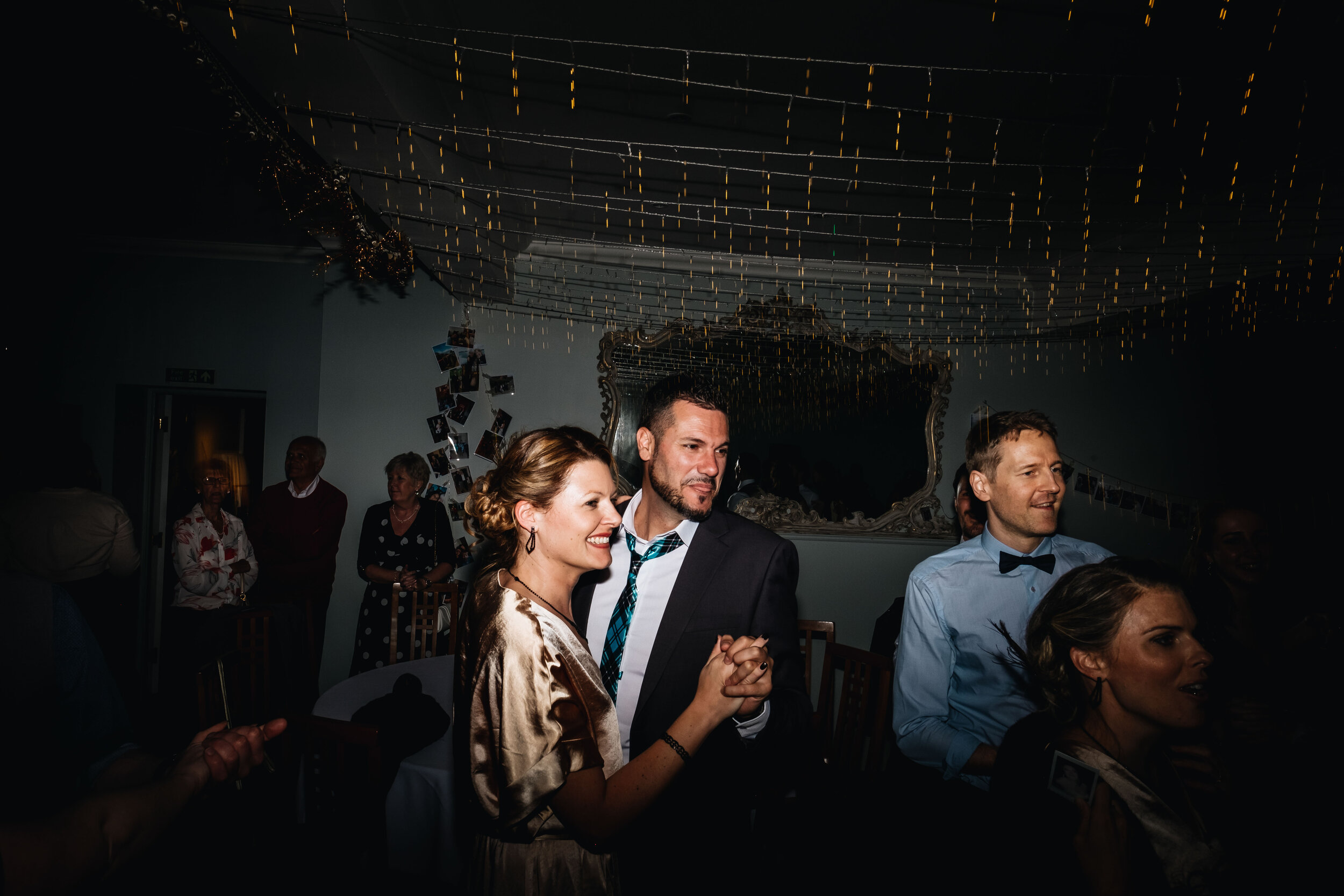 a couple are dancing on the dance floor