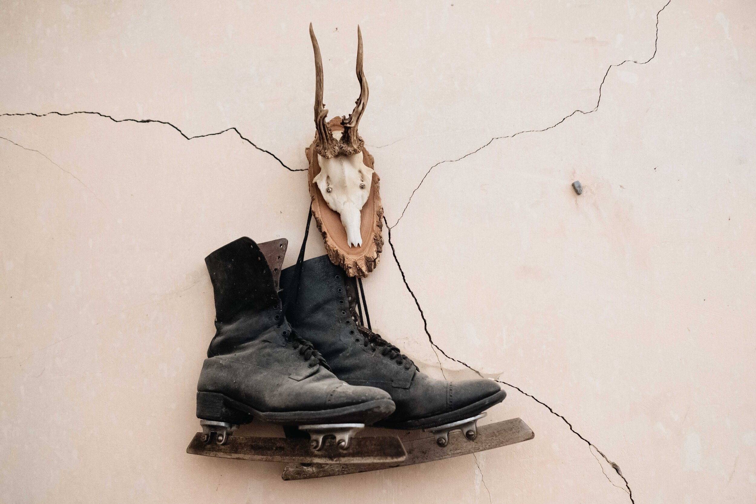 A retro pair of leather ice skates hangs on the wall of Cambo Country House and Estate.