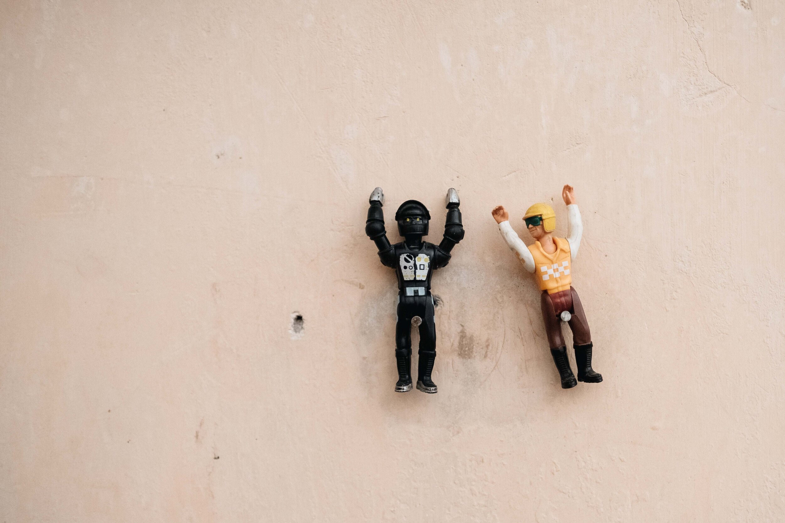 Two action figures are pinned to the wall of the Cambolious bar area.
