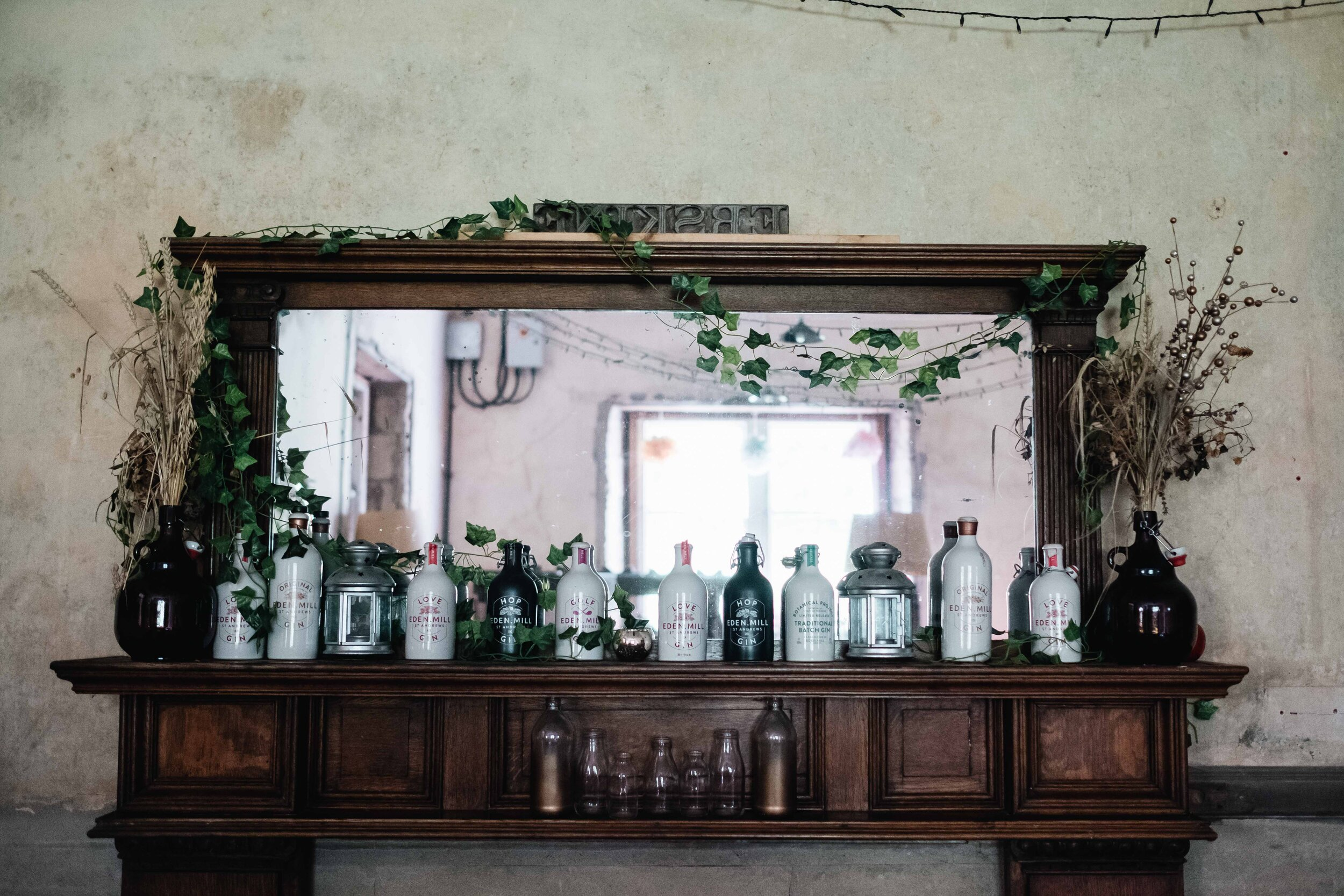 The mirror of the Cambolicious bar area is lined with Eden Mill Gin bottles.