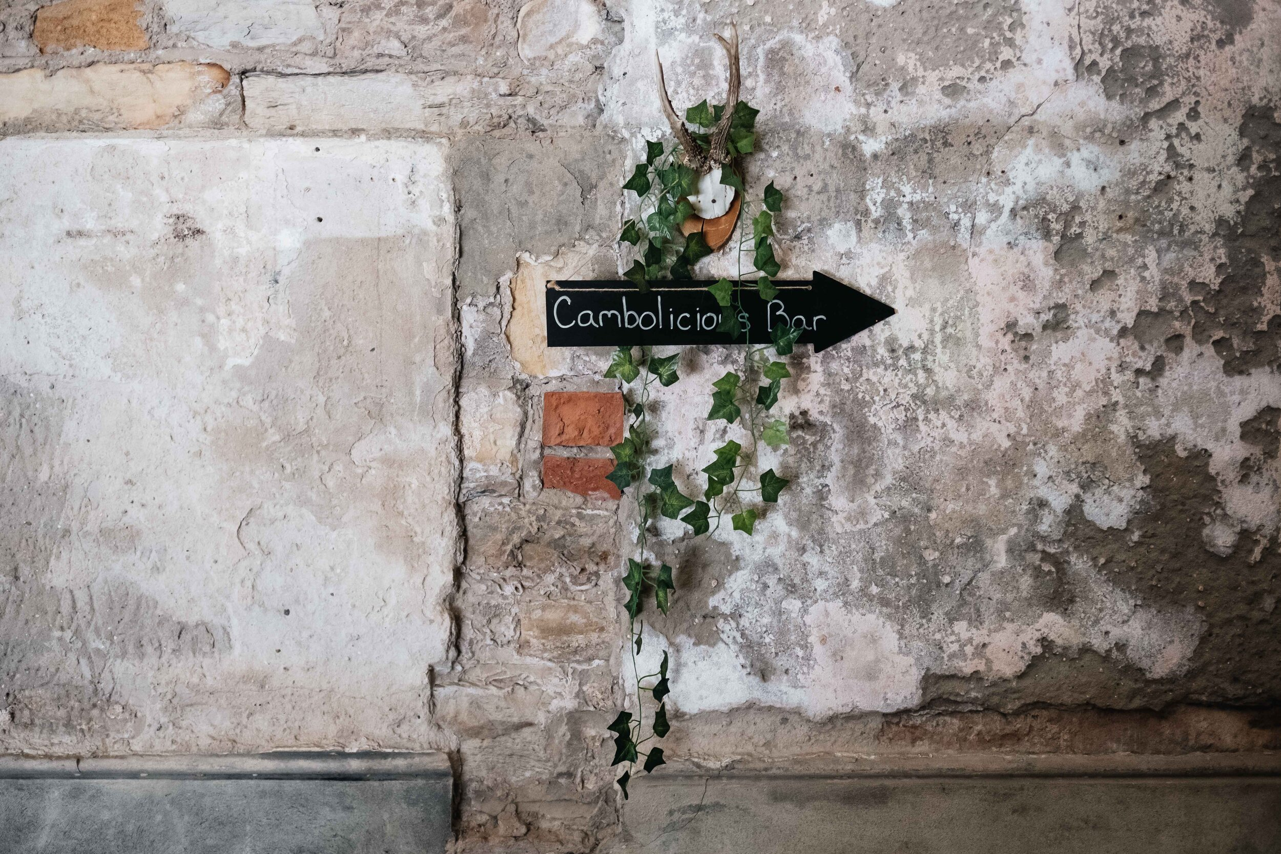 The Cambolicious arrow pointing to the direction of the bar is on the wall of Cambo House Estate.