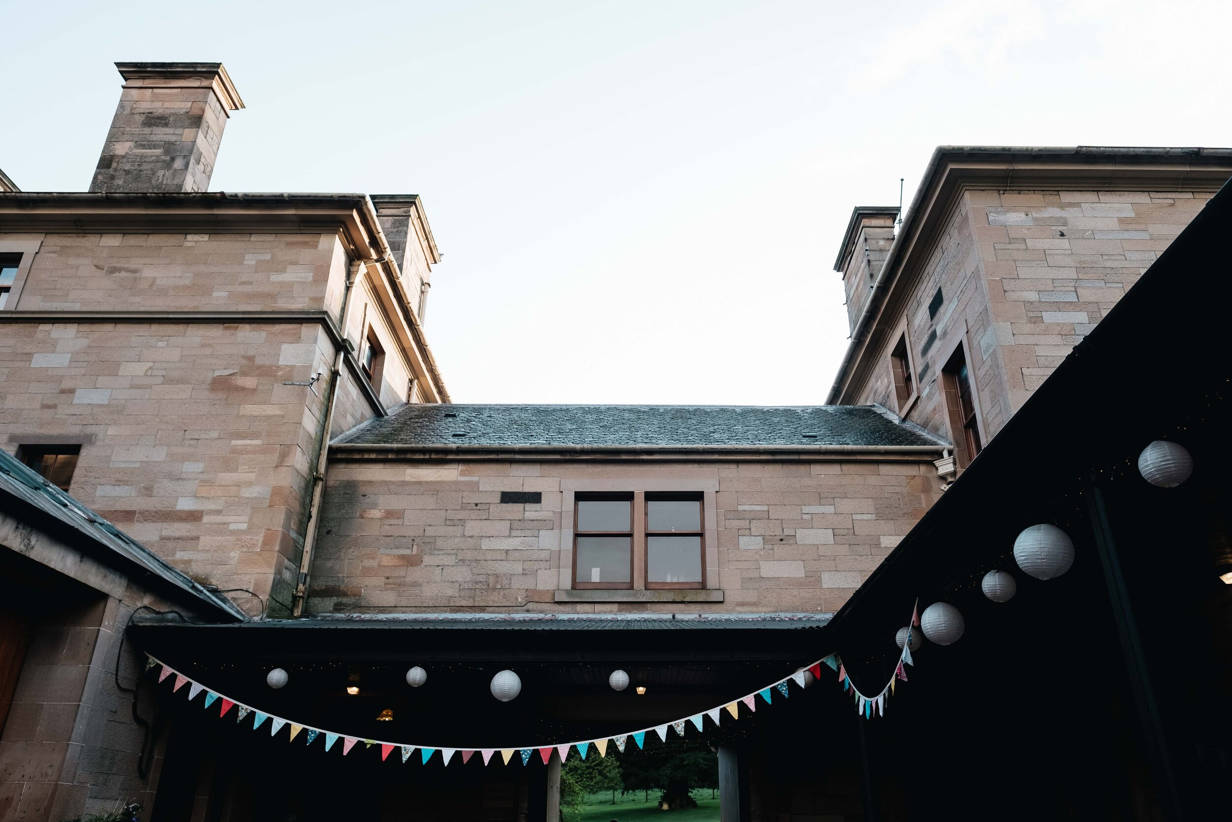 The court yard of Cambo House with bunting