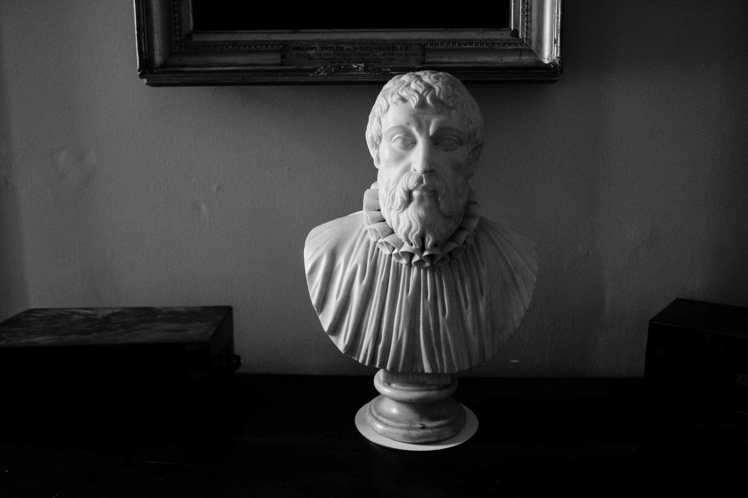 A bust sits on a sideboard of the main entrance to Cambo House