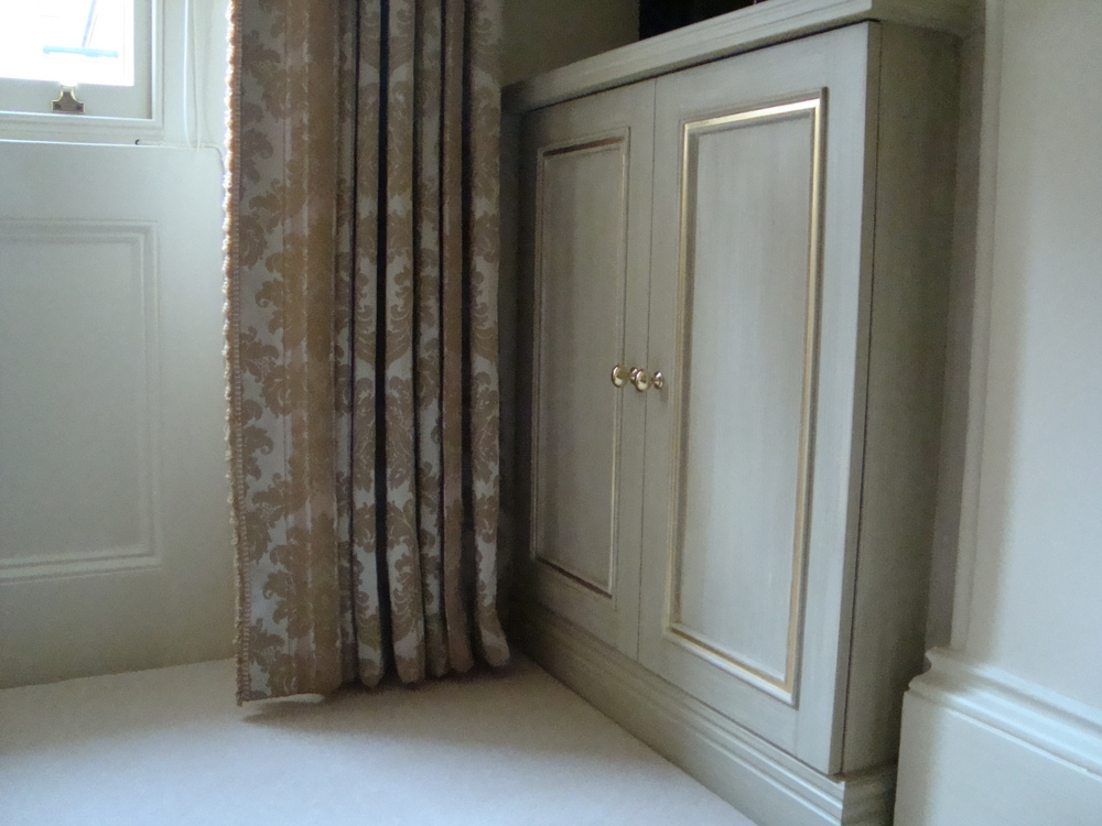 fitted handbuilt cupboard with specialist paint finish