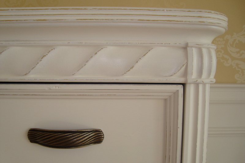 close up of subtle distressed paint finish chest of drawers