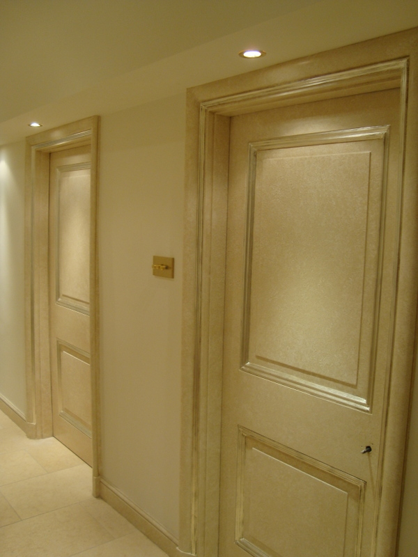 15 sides of Doors, Architraves and Skirting all recieved a specialist paint finish with gilded mouldings