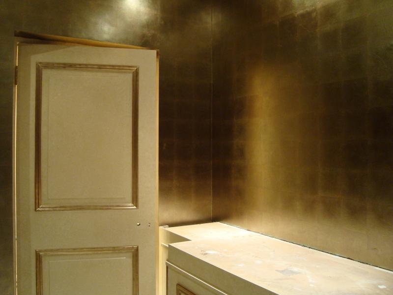 Gilded bathroom walls in variegated metal leaf.