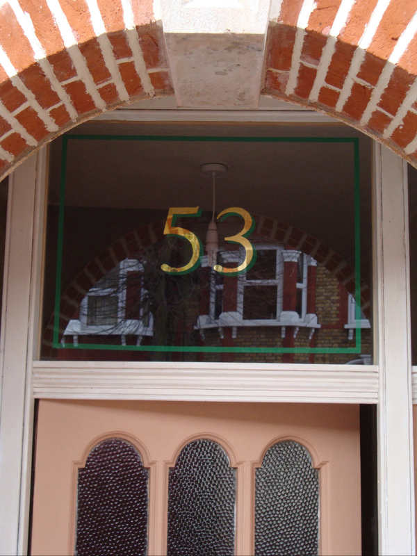 Verre Eglomise. House number glass gilded using 24crt gold leaf. Glass Gilded fanlight.