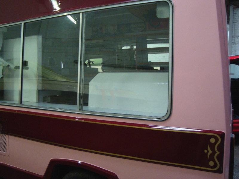 Gilded decoration onto the side of Gingers Comfort Emporium Icecream van