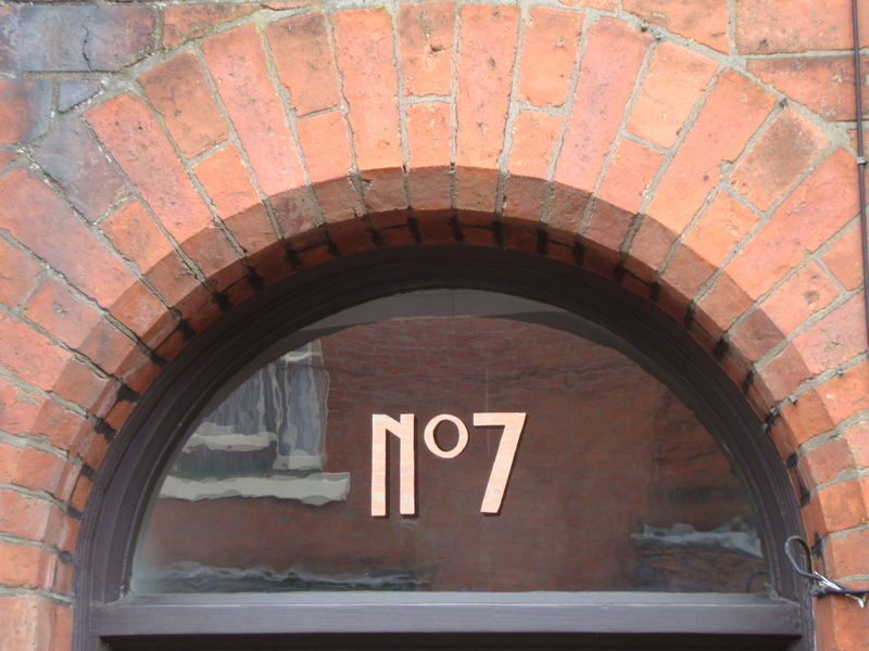 Glass Gilded house number in white gold.
