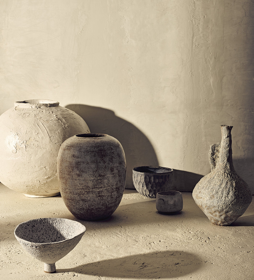 Clockwise from back left: No. vase with cracked Shino glaze, Dora Alzamora Good's hand-thrown stoneware vase, a textured glaze cereal bowl by Akiko Hirai and a terracotta tea bowl, jug and ceremonial vessel from Alana Wilson.CreditPhotograph by Brooke Holm. Styled by Victoria Petro Conroy