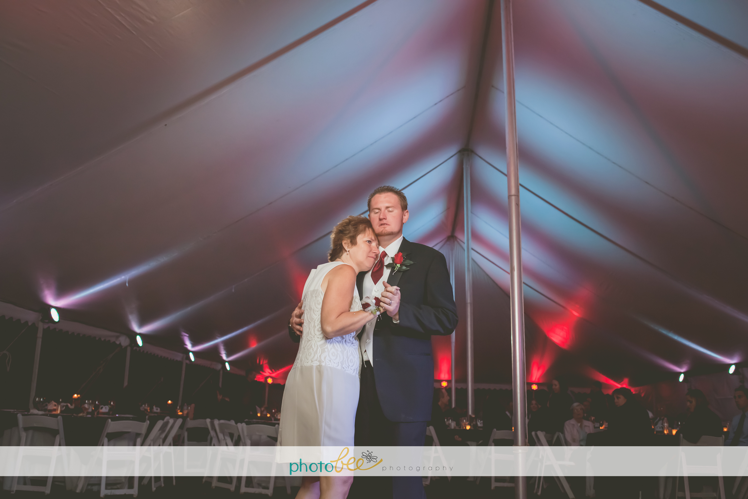 red and white uplighting in an outdoor tent