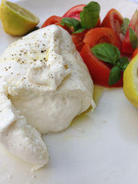 Instead of the traditional Caprese salad, try a creamy Burrata with your tomatoes.