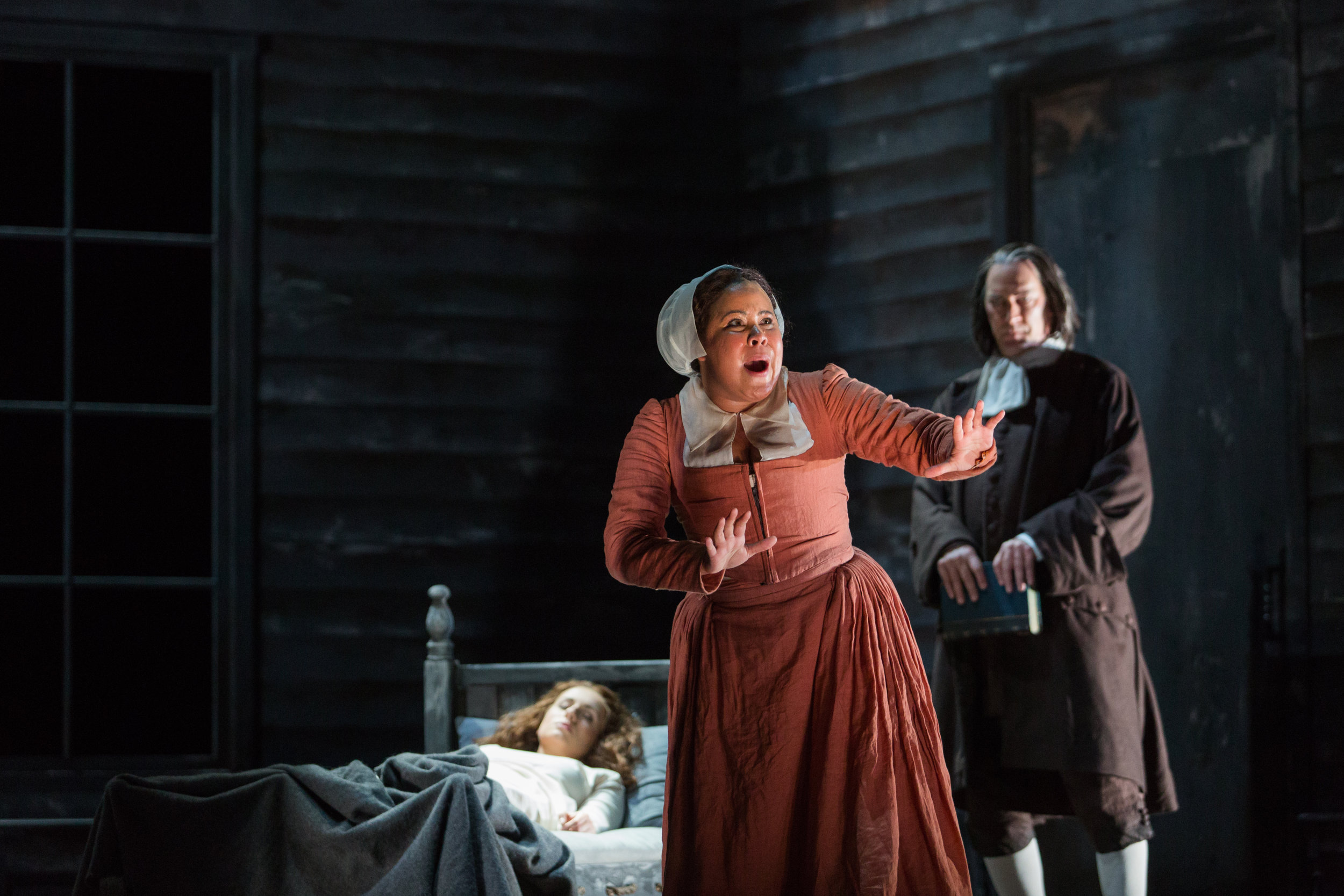 Ariana Wehr as Abigail Williams in The Glimmerglass Festival's 2016 production of The Crucible with David Pittsinger as Rev. Hale and Mary Beth Nelson as Betty Parris. Photo Credit: Karli Cadel