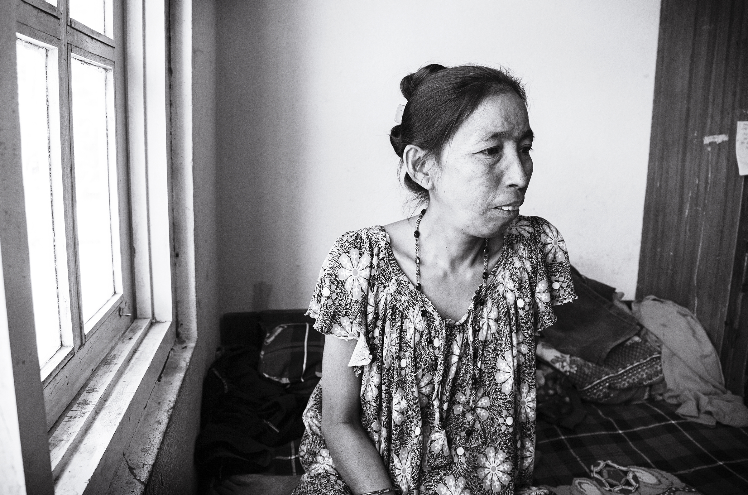 Phoolmaya spends much of her time inside of the family's room. Her level of activity is limited, as her knee, which she did not receive medical treatment for, continues to heal after being crushed in the earthquake.