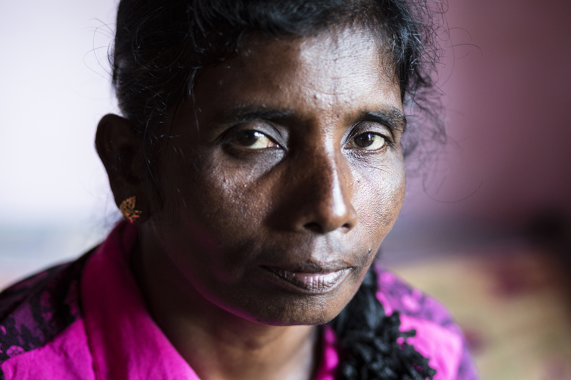 """Mary, 46. Mary has three sons, all of whom have been imprisoned or held within the LTTE army camps. She recounts her own time spent in a displacement camp after being taken by the army.  """"I remember the mango trees. We were the first ones the army captured there. The food was just thrown to people and sometimes we couldn't get anything to eat."""""""