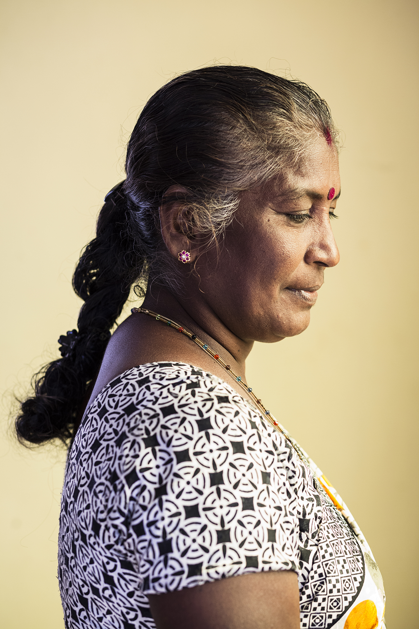 Anton, 55. Upon her 19 year old son being ordered to attend a hearing for suspicion of his involvement in LTTE, Anton accompanied him. It was the last time she saw her son. He is currently in Colombo prison.