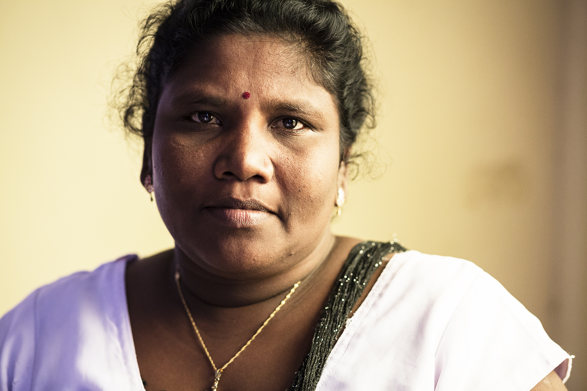 """Mariaselvi, 42. Mariaselvi's two brothers were allegedly detained by the Sri Lankan army in 1995 and 1998. She has not seen either of them since. She keeps her brother Robert's passport with her, in case he is found.  """"He had just gotten himself one to leave the country. He was supposed to travel to France to seek asylum, but the army caught him first."""""""
