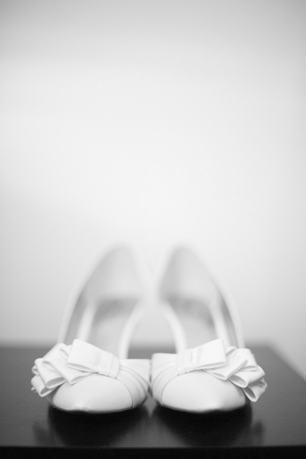 niagara-wedding-photographer-eva-derrick-photography-casablanca-winery-niagara-weddings-bride-groom-black-and-white-winter-wedding-photographers-bridal-shoes-white-shoes-photo.jpg
