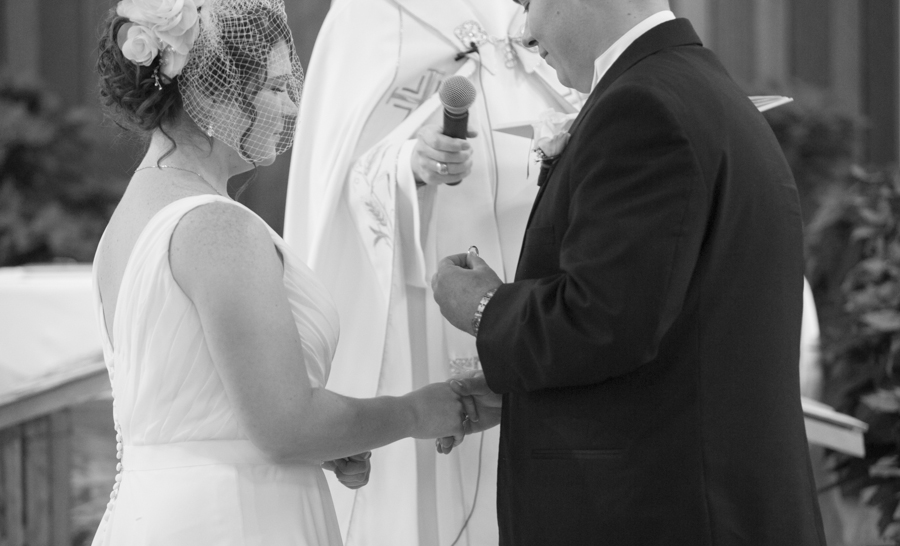 niagara-wedding-photographer-eva-derrick-photography-casablanca-winery-niagara-weddings-bride-groom-black-and-white-winter-wedding-photographers-rings-ring-exchange-wedding-ceremony-church-st-catharines-photo.jpg