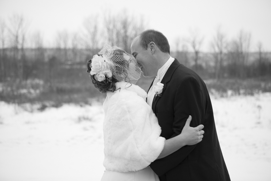 niagara-wedding-photographer-eva-derrick-photography-casablanca-winery-niagara-weddings-bride-groom-black-and-white-winter-wedding-photographers-couple-photography-laughing-kissing-photo.jpg